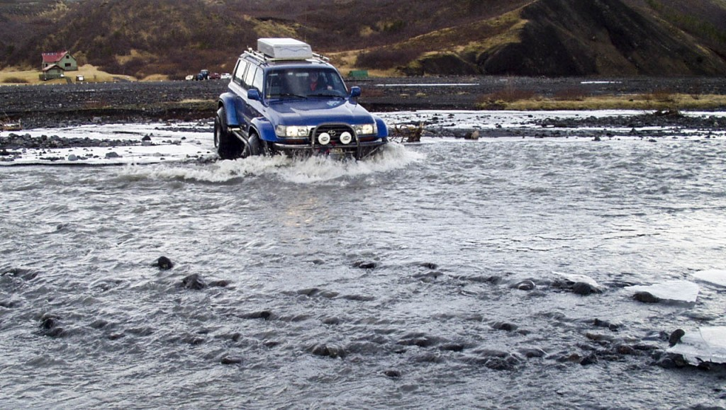 Crossing a glacier river in Thorsmork